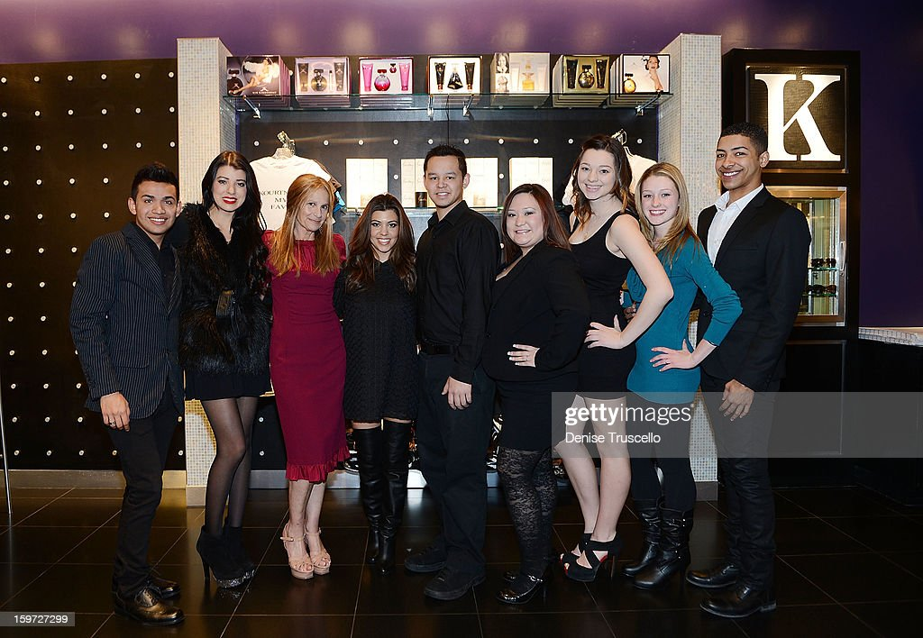 Cynthia Bussey (3rd from L) and Kourtney Kardashian (4th from L) pose with the Kardashian Khaos Team at Kardashian Khaos at The Mirage Hotel and Casino on January 19, 2013 in Las Vegas, Nevada.