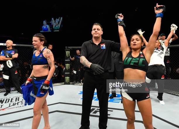 Cynthia Calvillo celebrates her victory over Joanne Calderwood of Scotland in their women's strawweight bout during the UFC Fight Night event at the...
