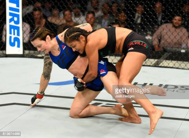Cynthia Calvillo takes down Joanne Calderwood of Scotland in their women's strawweight bout during the UFC Fight Night event at the SSE Hydro Arena...