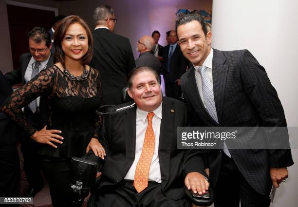 Cynthia Halelamien GSLD Host Mard Buoniconti and Helio Castroneves attend the 32nd Annual Great Sports Legends Dinner To Benefit The Miami...