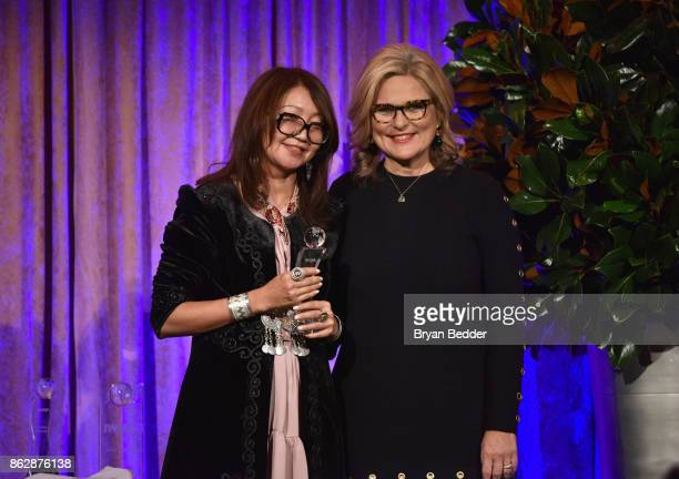 Cynthia McFadden presents award to Honoree Sanyia Toiken onstage at The International Women's Media Foundation's 28th Annual Courage In Journalism...