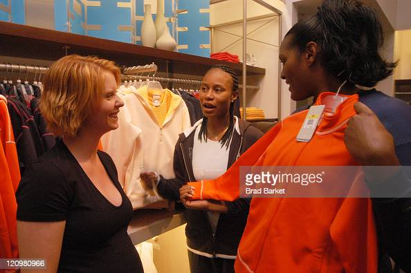 Cynthia Nixon and New York Liberty basketball players Vicky Johnson and Kym Hampton are seen at the grand opening of the Nike Goddess boutique at the...