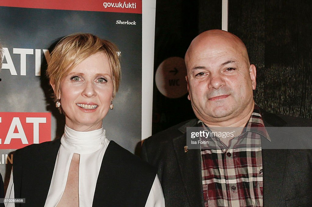 <a gi-track='captionPersonalityLinkClicked' href=/galleries/search?phrase=Cynthia+Nixon&family=editorial&specificpeople=202583 ng-click='$event.stopPropagation()'>Cynthia Nixon</a> and Sol Papadopoulos attend the Glashuette 'A Quiet Passion' Pre-Premiere Reception on February 14, 2016 in Berlin, Germany.