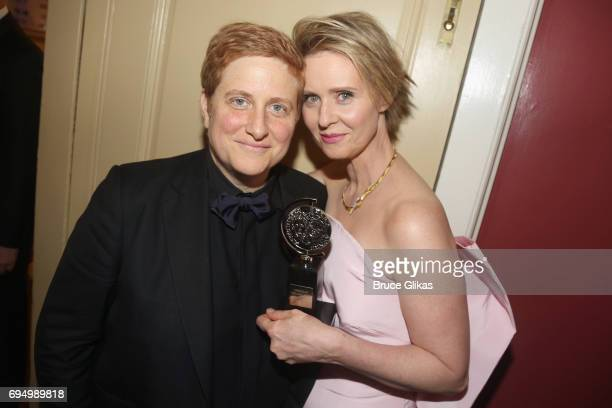"""Cynthia Nixon winner of the award for Best Featured Actress in a Play for """"The Little Foxes"""" poses with Christine Marinoni outside the press room..."""