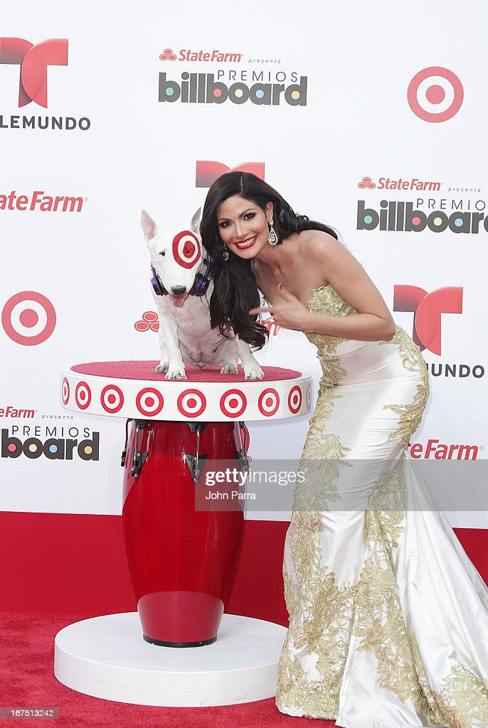 Cynthia Olavarria celebrates with Bullseye, Target's Beloved Bull Terrier Mascot, at the 2013 Billboard Latin Music Awards at BankUnited Center on April 25, 2013 in Miami, Florida.