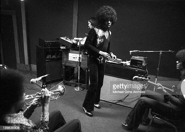 Cynthia Robinson Sly Stone and bassist Rustee Allen of the psychedelic soul group 'Sly and the Family Stone' record in the studio on April 3 1973 in...
