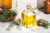 Cypress oil on glass bottle for beauty, skin care, wellness. Alternative medicine