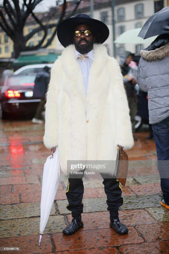 Cyprien Richiardi wears Borsalino hat, MGM bag on day 1 of Milan Fashion Week Womenswear Autumn/Winter 2014 on February 19, 2014 in Milan, Italy.