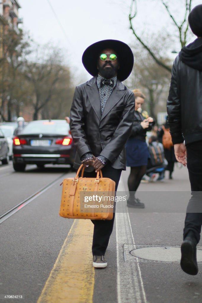 Cyprien Richiardi wears Matteo Ternullo jacket, Fendi shoes and MCM bag outside the Fendi Fashion Show on day 2 of Milan Fashion Week Womenswear Autumn/Winter 2014 on February 20, 2014 in Milan, Italy.