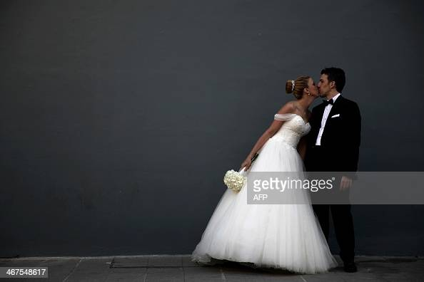 A Cypriot bride and groom pose for a picture after their wedding ceremony in the old city of the Cypriot capital Nicosia on February 5 2014 AFP...