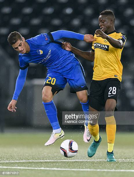 S Cypriot forward Pieros Sotiriou vies with Young Boys' Swiss midfielder Denis Zakaria during the Europa League group B football match beetween Young...