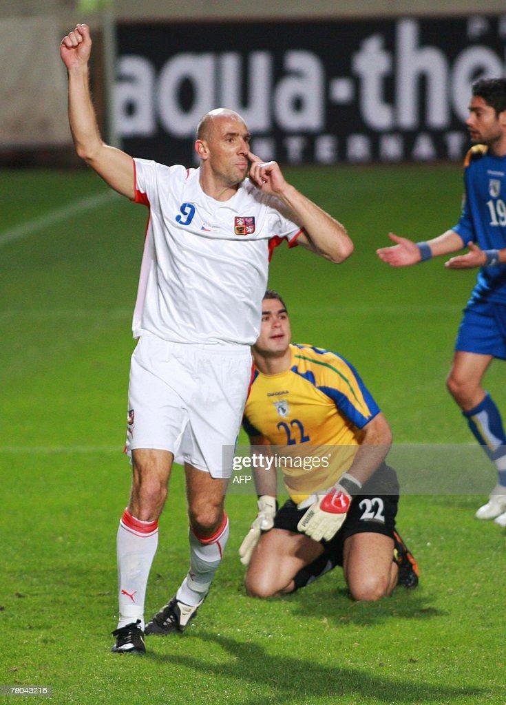 Cypriot goalkeeper Antonis Giorgallidi and his teammate Alexandros Garpozis react as Czech Jan Koller scores a goal during their Euro 2008 qualifying...