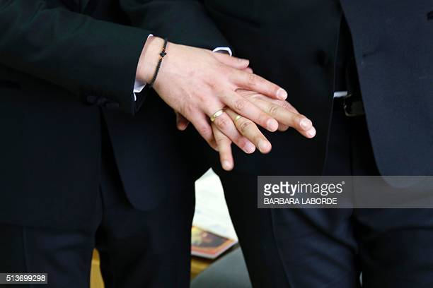 Cypriot Marios and Stephanos show their rings after their civil wedding ceremony on March 4 2016 at the District Administration Offices in the...