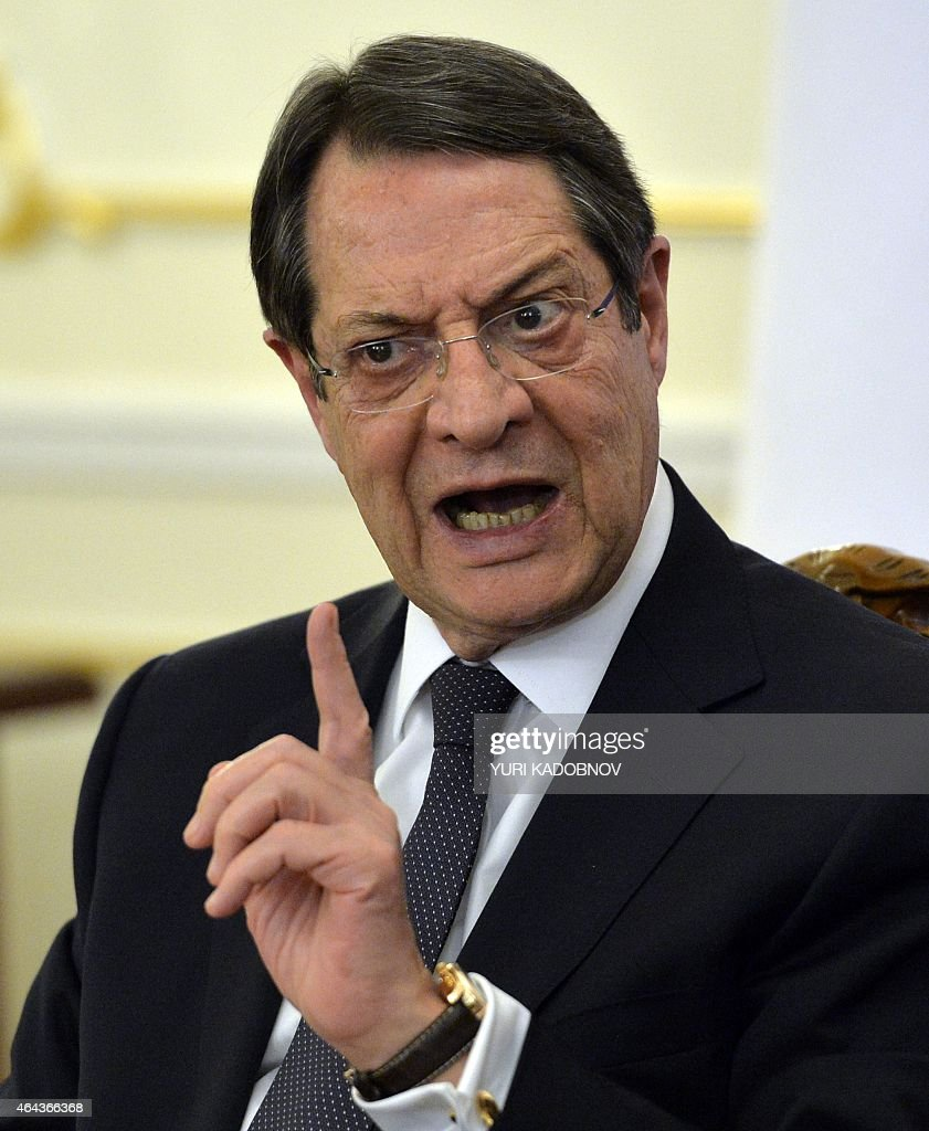 Cypriot President <a gi-track='captionPersonalityLinkClicked' href=/galleries/search?phrase=Nicos+Anastasiades&family=editorial&specificpeople=10113933 ng-click='$event.stopPropagation()'>Nicos Anastasiades</a> gestures as he speaks during a joint press conference with his Russian counterpart at the Novo-Ogaryovo residence outside Moscow on February 25, 2015.