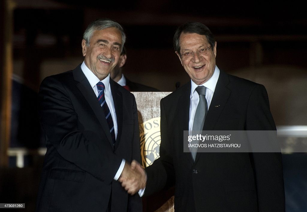 Cypriot President Nicos Anastasiades shakes the hand of Turkish Cypriot President of the selfproclaimed Turkish Republic of Northern Cyprus Mustafa...