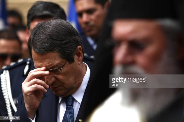Cypriot President Nicos Anastasiades stands along side Greek Orthodox Archbishop Chrisostomos II as they attend the memorial for the heroes of the...