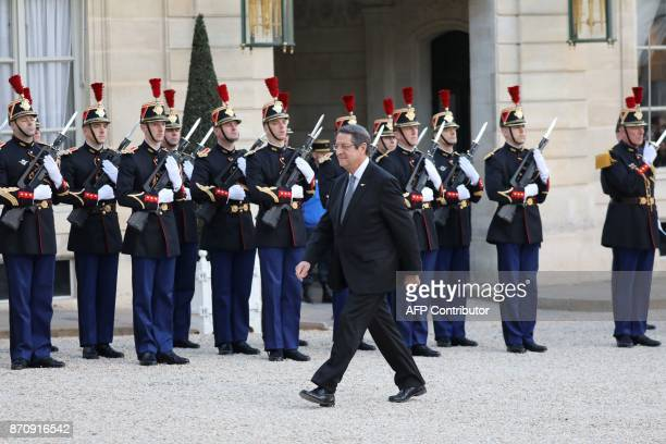 Cypriot President Nicos Anastasiades walks past Republican Guards upon his arrival for a meeting with his French counterpart at the Elysee palace on...