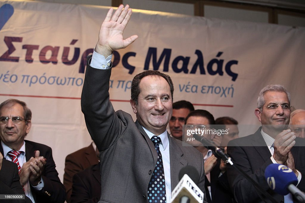 Cypriot presidential election candidate Stavros Malas waves after delivering a speech as he campaigns on January 10, 2013 in Larnaca. The first round of Cyprus' presidential election will take place on February 17.