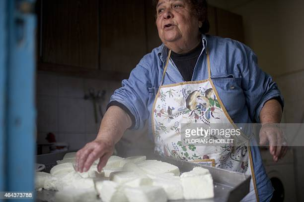A Cypriot woman prepares traditional halloumi cheese at her house in Astromeritis village located some 30 km west of the capital Nicosia on the...