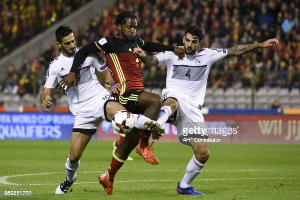 TOPSHOT Cyprus' defender Konstantinos Laifis vies with Belgium's forward Michy Batshuayi during the FIFA World Cup 2018 qualification football match...