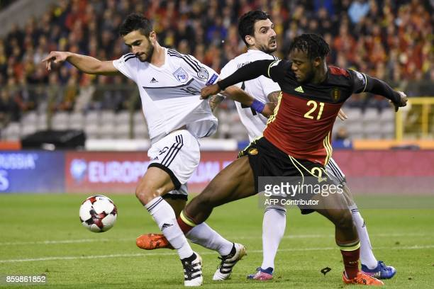 Cyprus' defender Konstantinos Laifis vies with Belgium's forward Michy Batshuayi during the FIFA World Cup 2018 qualification football match between...