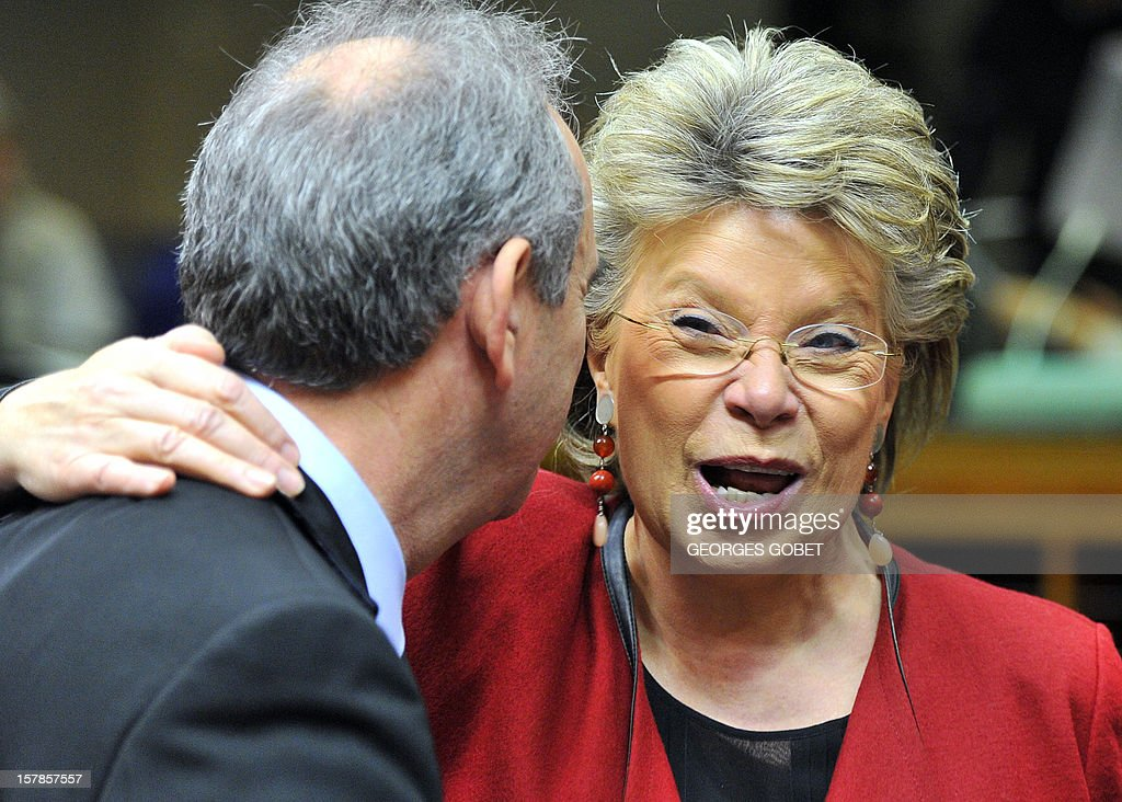 Cyprus' Justice minister Loukas Louka (L) talks with EU Commissioner for Justice, Fundamental Rights and Citizenship Viviane Reding prior to a Justice and Home Affairs Council on December 7, 2012 at the EU Headquarters in Brussels. Justice ministers will be called on to agree a general approach on three legislative proposals as a directive establishing minimum rules for criminal sanctions for the most serious market abuse offences, namely insider dealing and market manipulation ('market abuse directive'), a directive on the freezing and confiscation of proceeds of crime in the EU. The proposal aims to make it easier for national authorities to confiscate and recover the profits that criminals make from cross-border and organised crime, a regulation on mutual recognition of protection measures in civil matters upon request of the person at risk , aimed at strengthening the rights of victims.