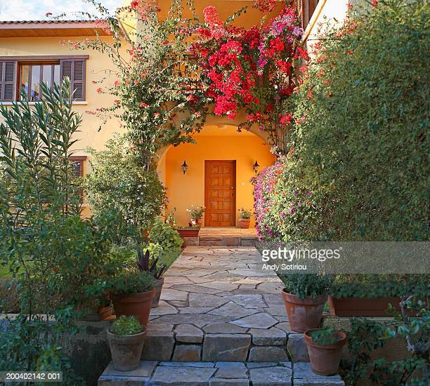 Cyprus, Limassol, plants surrounding front walkway of townhouse