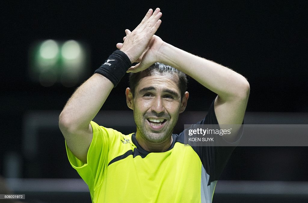 Cyprus' Marcos Baghdatis celebrates after winning his first round match against Belgium's David Goffin during the ABN AMRO World Tennis Tournament in Rotterdam, on February 9, 2016. / AFP / ANP / Koen Suyk / Netherlands OUT