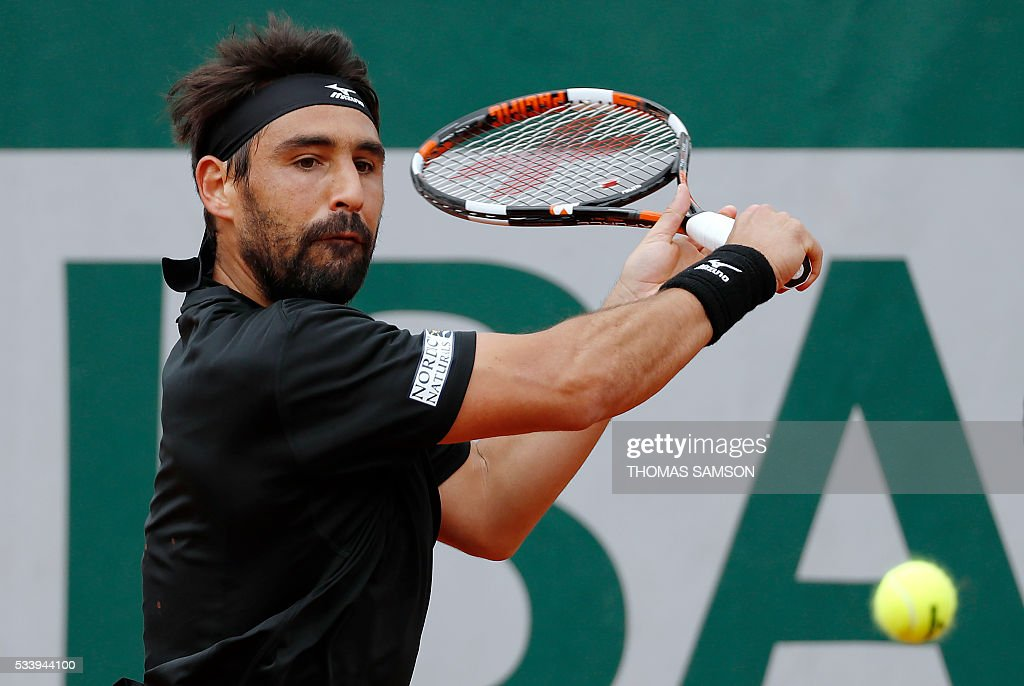 Cyprus' Marcos Baghdatis returns the ball to Luxemburg's Gilles Muller during their men's first round match at the Roland Garros 2016 French Tennis Open in Paris on May 24, 2016. / AFP / Thomas SAMSON