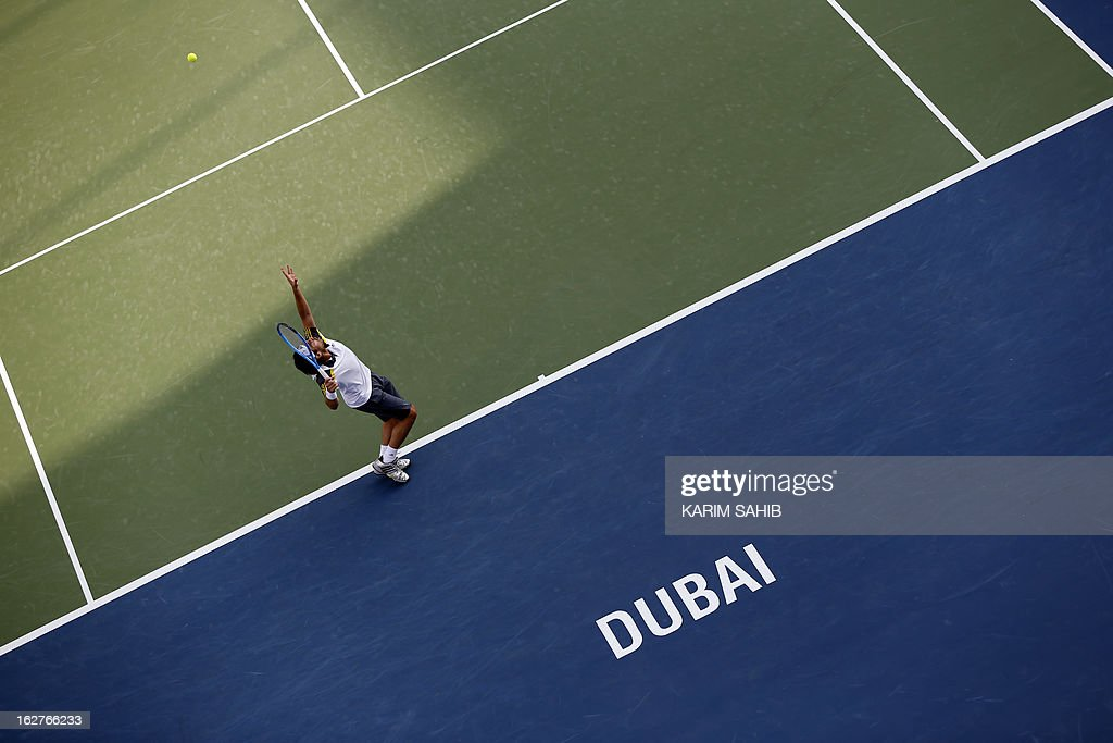 Cyprus' Marcos Baghdatis serves to Argentina's Juan Martin Del Potro during their ATP Dubai Open tennis match in the Gulf emirate on February 26, 2013.