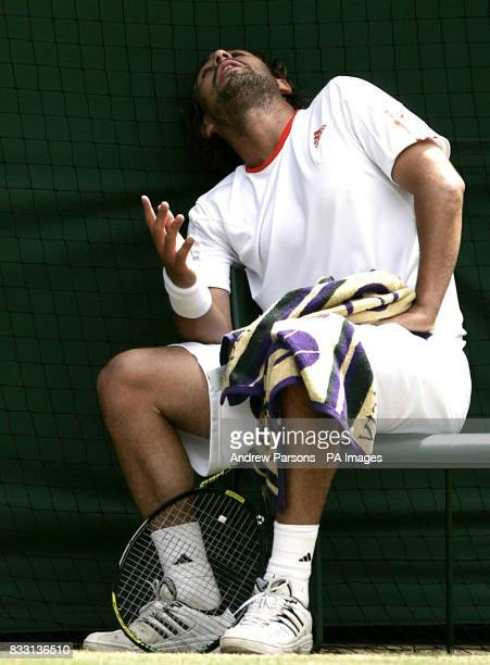 Cyprus' Marcos Baghdatis shows his frustration in his match against Serbia's Novak Djokovic during The All England Lawn Tennis Championship at...