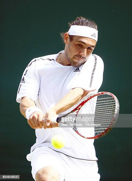 Cyprus' Marcus Baghdatis in action against Spain's Feliciano Lopez