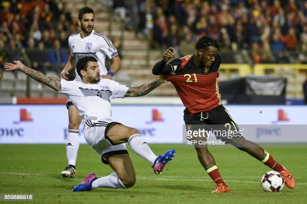 Cyprus' midfielder Giorgos Merkis vies with Belgium's forward Michy Batshuayi during the FIFA World Cup 2018 qualification football match between...