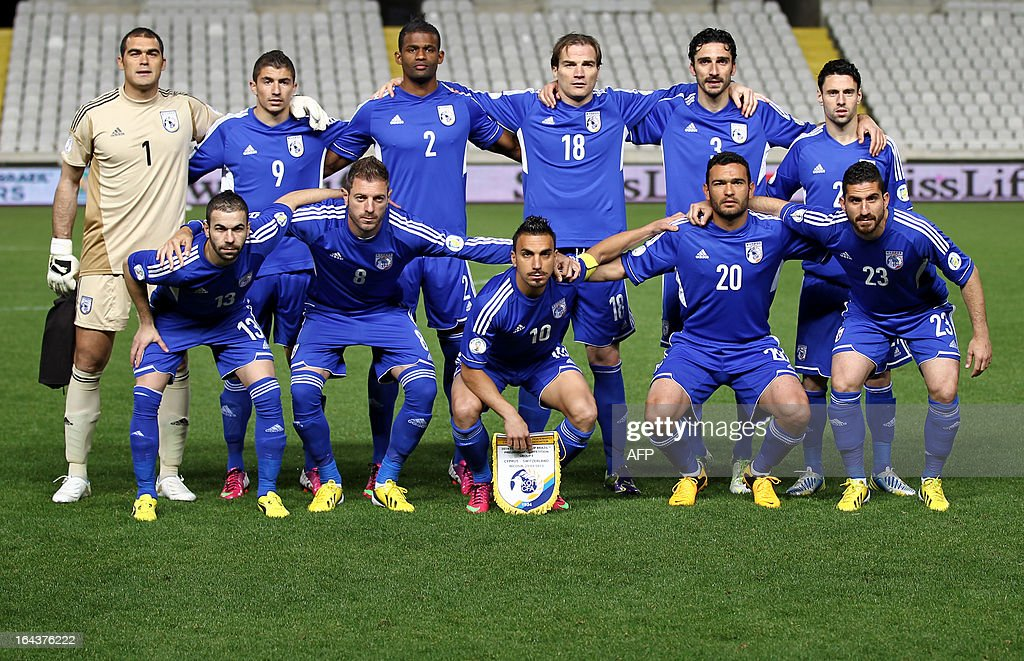 Cyprus' national football team players pose for a group picture before the 2014 World Cup European zone group E qualifying football match between Cyprus and Switzerland at GSP Stadium in Nicosia on March 23, 2013.