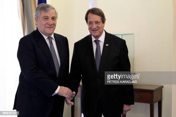 Cyprus President Nicos Anastasiades and European Parliament President Antonio Tajani talk during their meeting at the presidential palace in the...