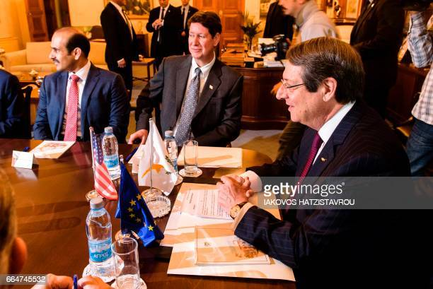 Cyprus President Nicos Anastasiades sits next to Andrew Swiger Senior Vice President of ExxonMobil Corporation and Saad Sherida AlKaabi President and...