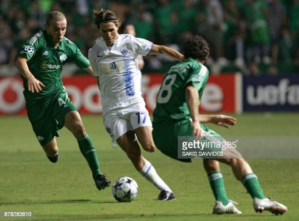 Cypruss Anorthosis Famagusta player Savio vies with Panathinaikos players Giannis Goumas and Marcelo Mattos during their UEFA Champions League Group...