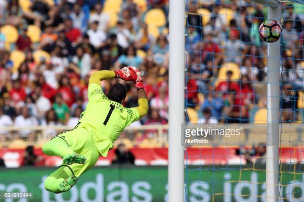 Cypruss goalkeeper Antonis Giorgallidis can't safe a ball shoots by Portugal's midfielder Joao Moutinho during the friendly football match Portugal...