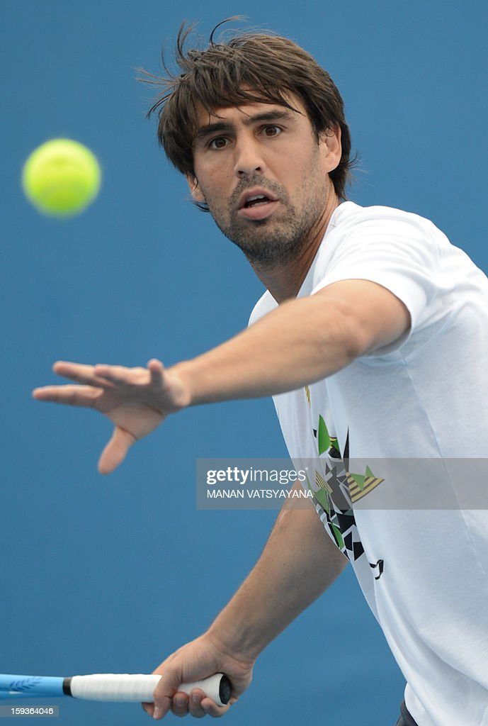 Cyprus's Marcos Baghdatis watches the ball as he plays a return during a practice session ahead of the 2013 Australian Open tennis tournament on January 13, 2013. AFP PHOTO/MANAN VATSYAYANA IMAGE STRICTLY RESTRICTED TO EDITORIAL USE - STRICTLY NO COMMERCIAL USE