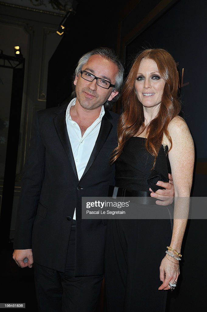 Cyriel Chapuy and <a gi-track='captionPersonalityLinkClicked' href=/galleries/search?phrase=Julianne+Moore&family=editorial&specificpeople=171555 ng-click='$event.stopPropagation()'>Julianne Moore</a> pose during the l'Oreal new egerie presentation at Hotel D'Evreux on November 15, 2012 in Paris, France.