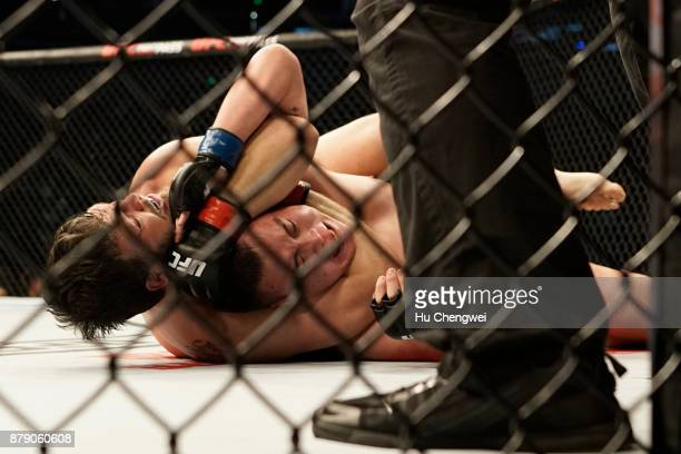 Cyril Asker fights with Hu Yaozong during the UFC Fight Night at MercedesBenz Arena on November 25 2017 in Shanghai China