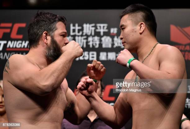 Cyril Asker of France and Hu Yaozong of China face off during the UFC Fight Night weighin on November 24 2017 in Shanghai China