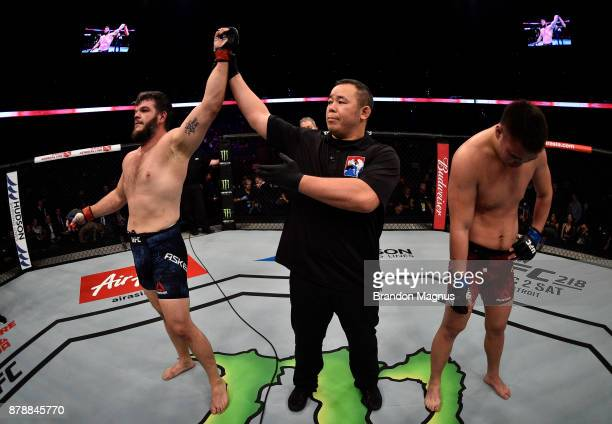 Cyril Asker of France celebrates after his submission victory over Hu Yaozong of China in their heavyweight bout during the UFC Fight Night event...