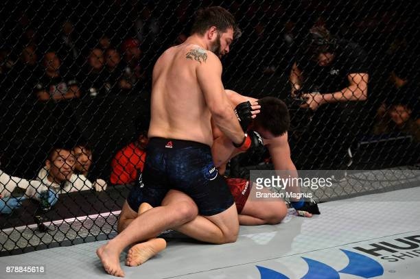 Cyril Asker of France punches Hu Yaozong of China in their heavyweight bout during the UFC Fight Night event inside the MercedesBenz Arena on...