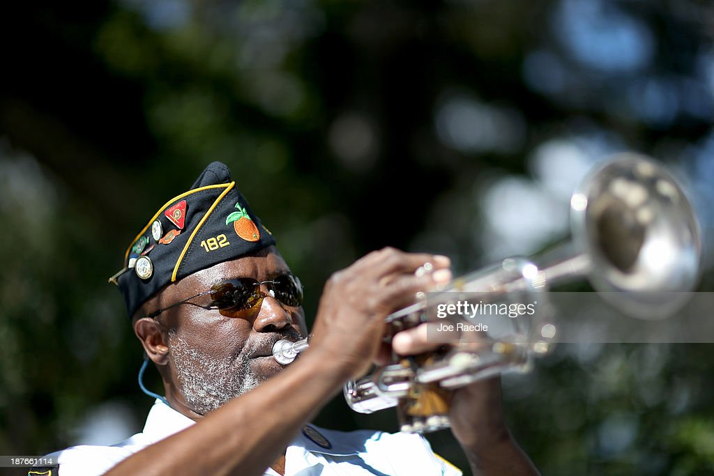 Cyril Bullard retired from the United States Army plays the trumpet during a Veterans Day ceremony at the Coconut Grove Bahamian cemetery on November 11, 2013 in Coconut Grove, Florida. The ceremony was held by the Coconut Grove American Legion Post #182 in honor of those veterans who have served the United States.