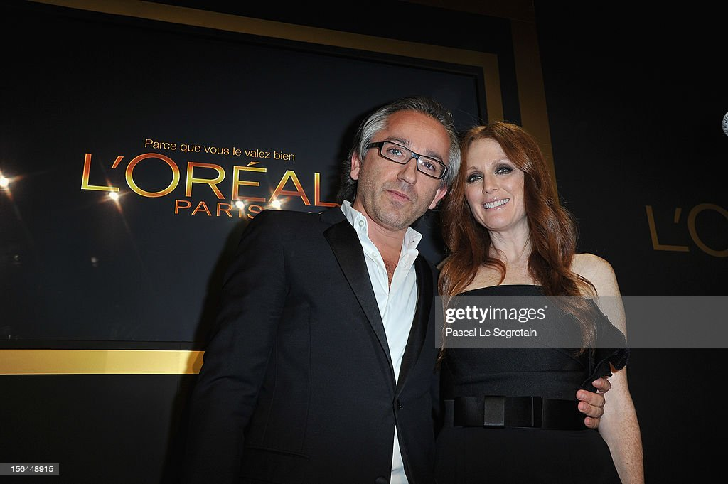 Cyril Chapuy and Julianne Moore attend the l'Oreal new egerie presentation at Hotel D'Evreux on November 15, 2012 in Paris, France.
