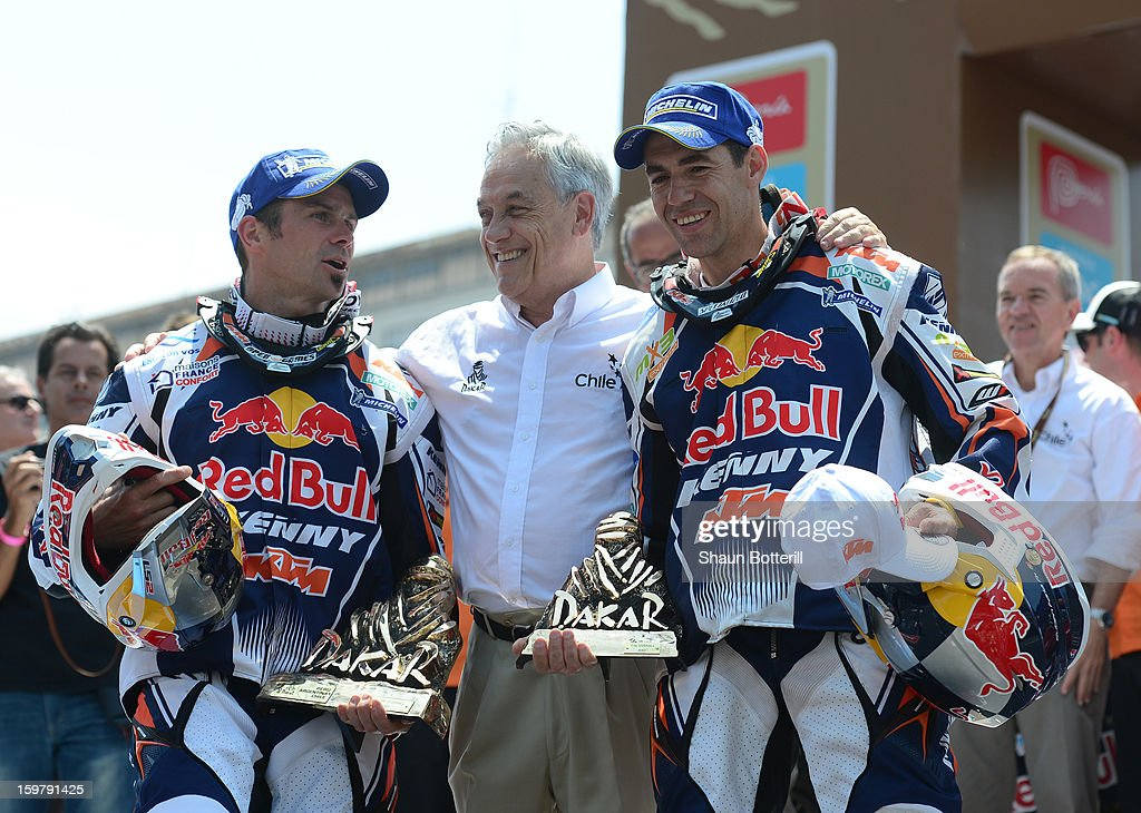 Cyril Despres, first place in Motos (L) and Ruben Faria, 2nd place, of KTM Red Bull Rally Factory Team celebrate with President of Chile Sebastian Pinera during the podium presentations at the end of the 2013 Dakar Rally on January 20, 2013 in Santiago, Chile.