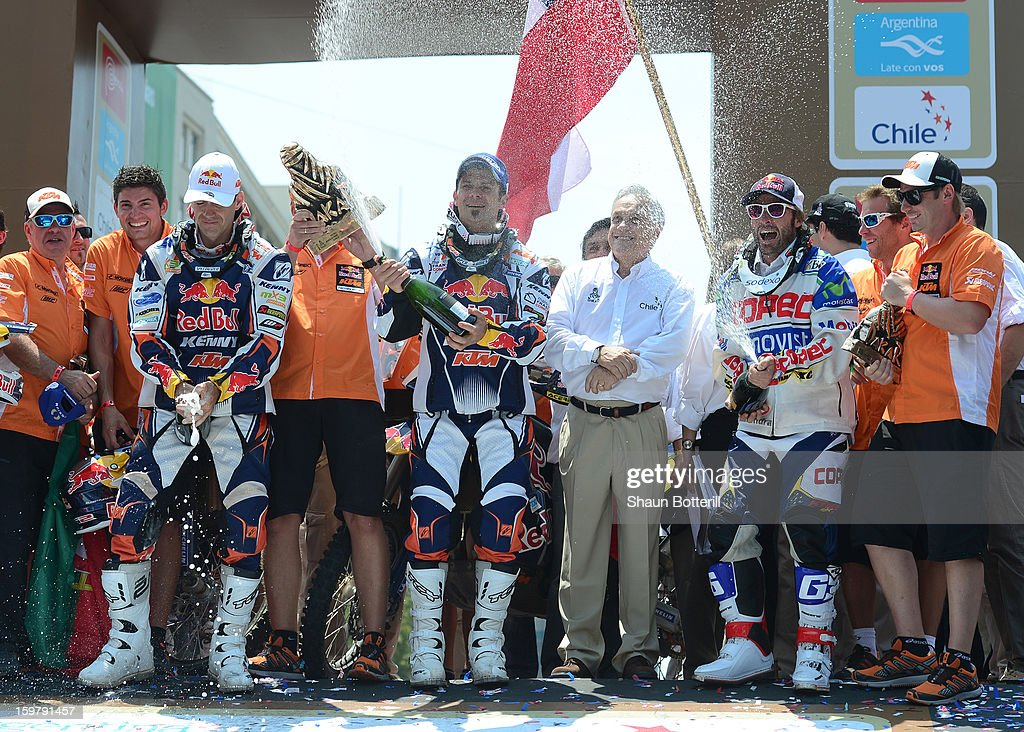 Cyril Despres, first place in Motos (C), Ruben Faria, 2nd place, of KTM Red Bull Rally Factory Team (L) and 3rd place Francisco Chaleco Lopez Contardo of Chile celebrate during the podium presentations at the end of the 2013 Dakar Rally on January 20, 2013 in Santiago, Chile.