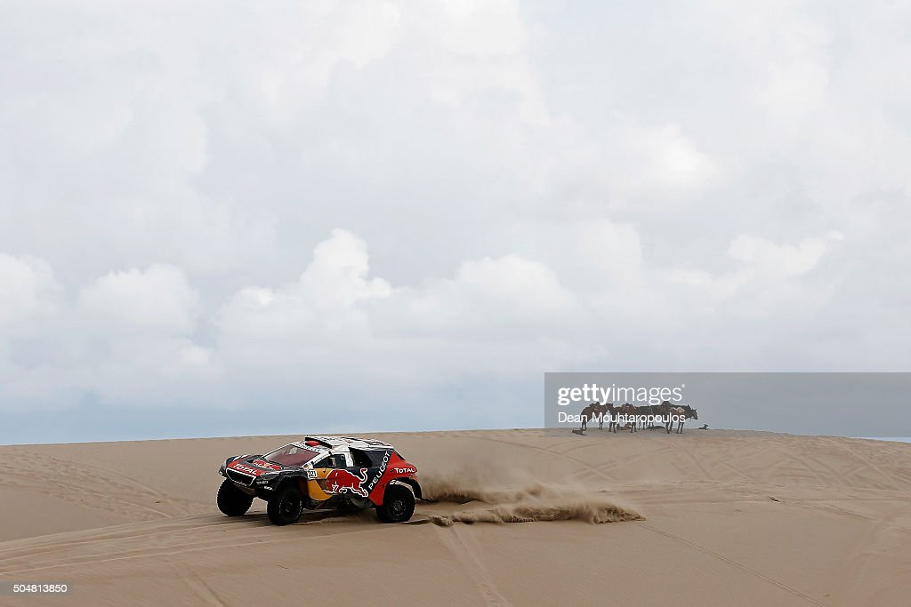 Cyril Despres of France and David Castera of France in the PEUGEOT 2008 DKR for TEAM PEUGEOT pass a group or team of horses while competing on day 11...