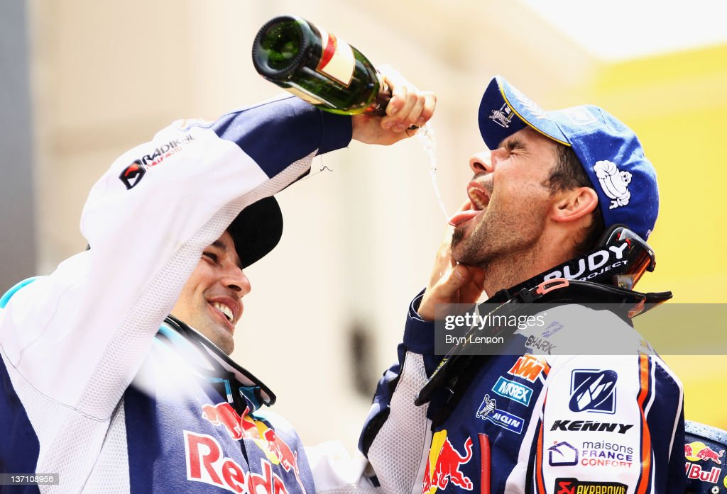 <a gi-track='captionPersonalityLinkClicked' href=/galleries/search?phrase=Cyril+Despres&family=editorial&specificpeople=2092881 ng-click='$event.stopPropagation()'>Cyril Despres</a> of France and Team Red Bull KTM celebrates on the podium after winning the motorbike category of the 2012 Dakar Rally from Pisco to Lima on January 15, 2012 in Lima, Peru.